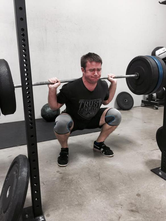 J. D.  hits the bottom of a heavy squat.